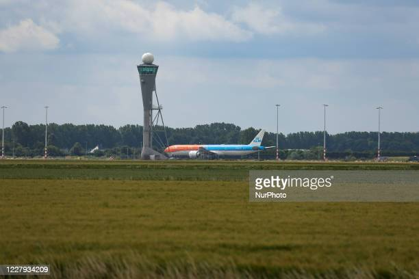 Royal Dutch Airlines Boeing 777 passenger aircraft as seen flying on final approach for landing, touch down, breaking and taxiing at Polderbaan...