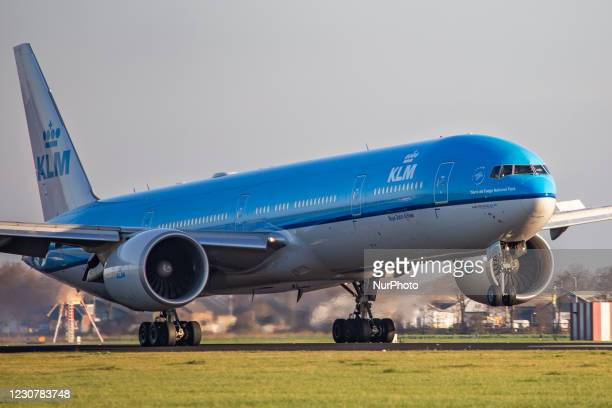 Royal Dutch Airlines Boeing 777-300 aircraft as seen on final approach flying and landing at Polderbaan runway in Amsterdam Schiphol Airport AMS...