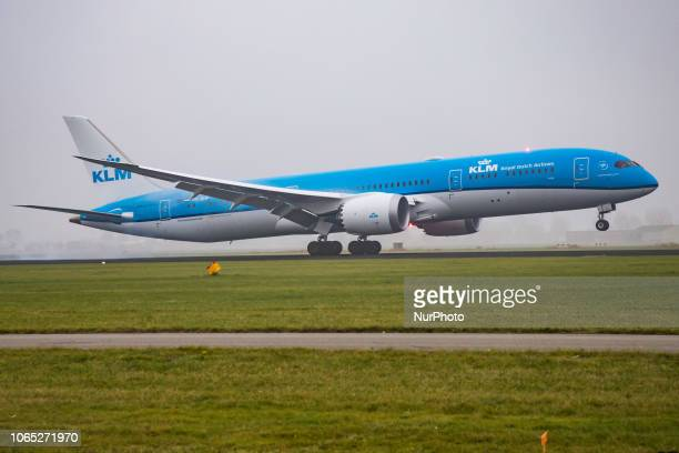 KLM Royal Dutch Airlines Boeing 7879 Dreamliner with registration PHBHP is landing in the haze in Amsterdam Schiphol Airport in The Netherlands The...