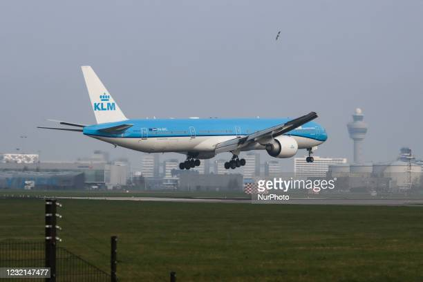 Royal Dutch Airlones Boeing 777-300 aircraft as seen flying on final approach for landing at Amsterdam Schiphol AMS EHAM international airport. The...
