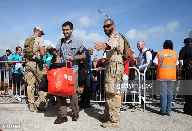 Royal Dutch Marines manage evacuation procedures at Princess Juliana Airport on September 11 2017 in Philipsburg St Maarten The Caribbean island...