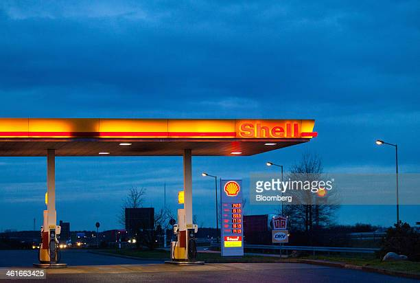 A Royal Dutch Shell Plc gas station sits illumiinated at night on the A12 highway near Biegen Germany on Thursday Jan 9 2014 The European Commission...