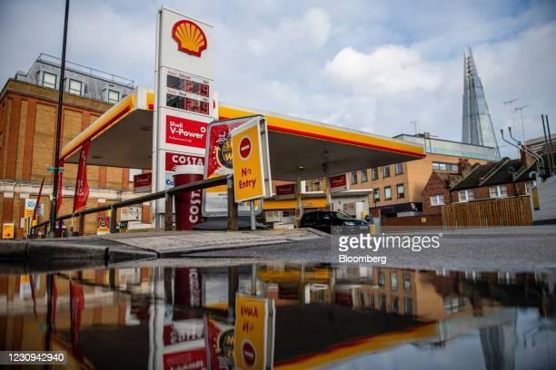 Royal Dutch Shell Plc petrol station in view of The Shard skyscraper in London, U.K., on Tuesday, Feb 2021. Royal Dutch Shell Plc, which reports...