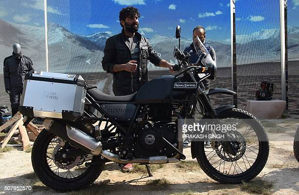 Royal Enfield MD CEO Siddhartha Lal poses with new motorcycle 'Himalayan' in New Delhi on February 2 2016 Royal Enfield introduced purposebuilt...