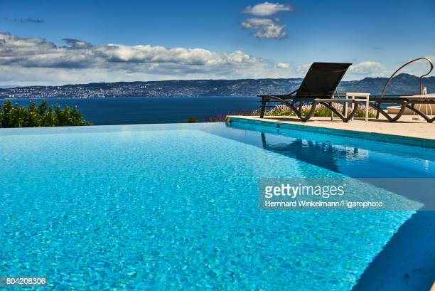 Royal Evian Resort's swimming pool overlooking Lake Geneva is photographed for Madame Figaro on June 7 2017 in EvianlesBains France CREDIT MUST READ...