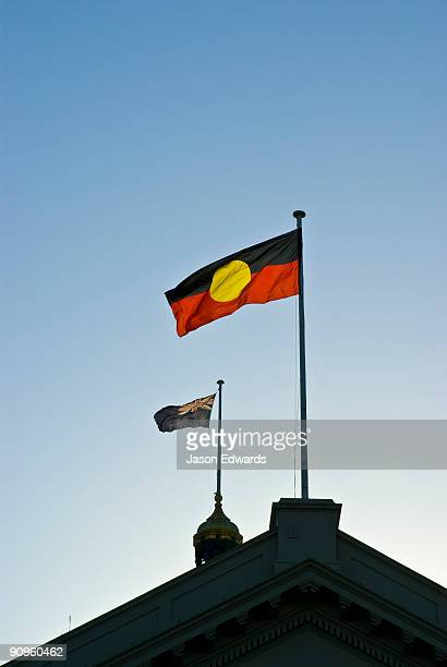 The Aboriginal Flag flying proudly with the national flag of Australia