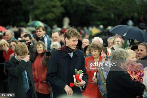 Royal Family Attending Christmas Day Service At Sandringham Church Prince William Carrying Presents Given To Him By People In The Crowd Walking With...
