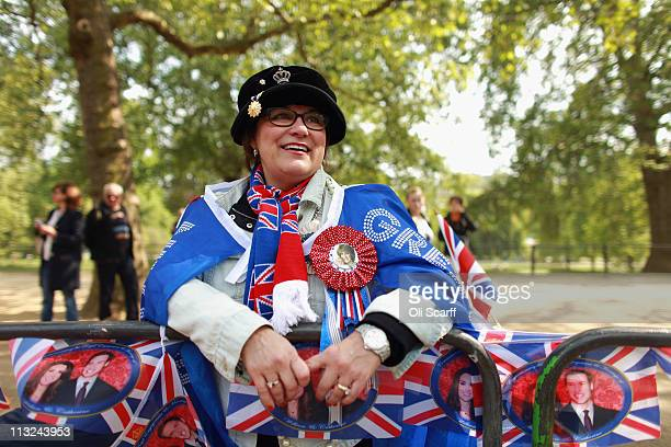 Royal family fan Jane Giannoulas from San Diego USA rests on the Mall to wait for a sight of the Prince William and Catherine Middleton returning to...