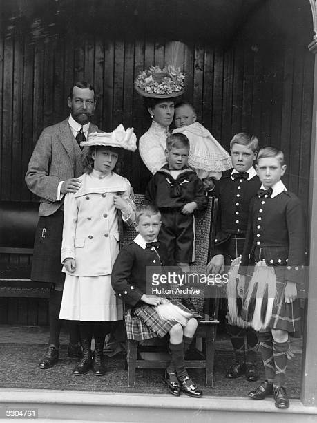 A royal family group during a visit to Abergeldie circa 1906 From back left the Prince of Wales Mary Princess Royal the Princess of Wales holding...