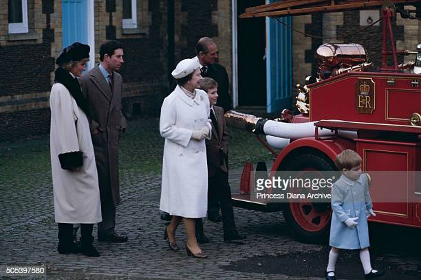 A royal family visit to a museum in Sandringham where the children climb on a fire engine January 1988 From left to right Princess Diana Prince...
