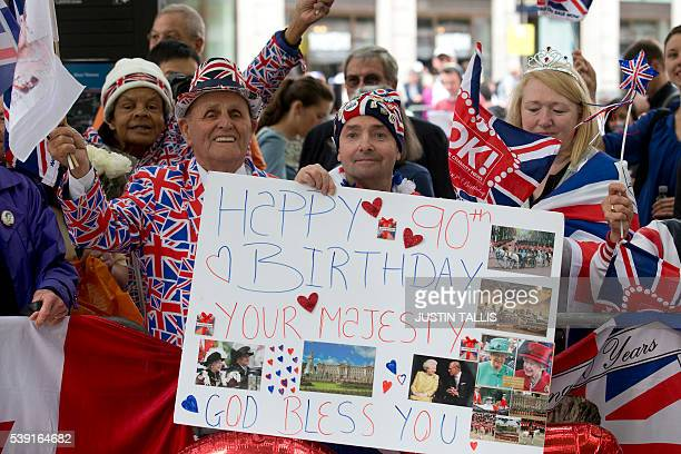 A Royal Fan Hold Up Birthday Card For Britains Queen Elizabeth II On It Ahead