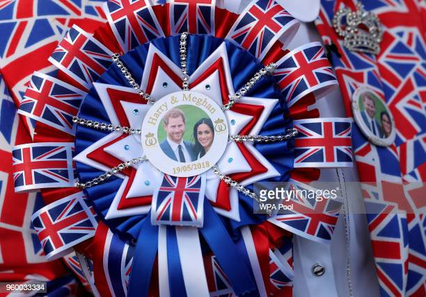 A royal fan wears a Prince Harry and Meghan Markle Union Jack rosette at Windsor Castle on May 19 2018 in Windsor England
