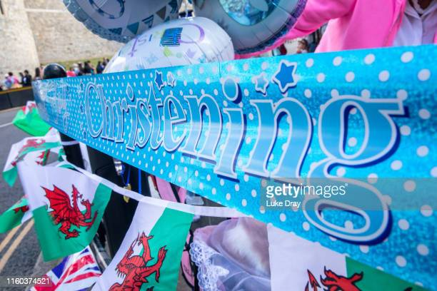 Royal fans celebrate the christening on the day that Archie Harrison MountbattenWindsor son of The Duke Duchess of Sussex was christened on July 06...