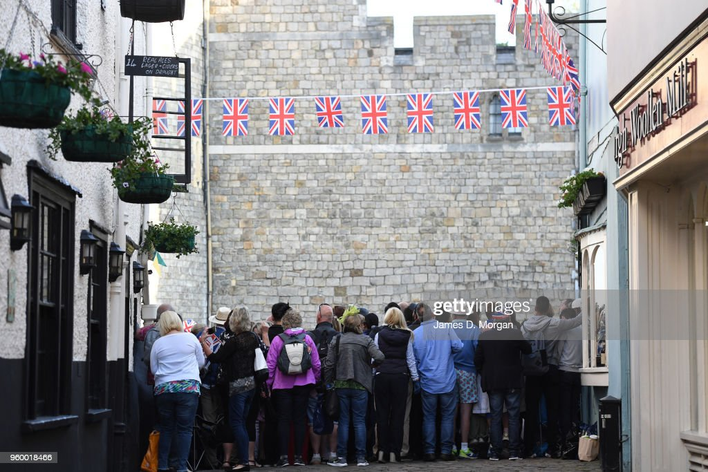 Royal fans cram onto a street near the castle before the wedding of Prince Harry to Ms. Meghan Markle at St George's Chapel, Windsor Castle on May 19, 2018 in Windsor, England. Prince Henry Charles Albert David of Wales marries Ms. Meghan Markle in a service at St George's Chapel inside the grounds of Windsor Castle. Among the guests were 2200 members of the public, the royal family and Ms. Markle's Mother Doria Ragland.