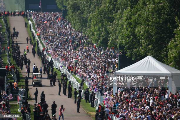 Royal fans gather along the Long Walk ahead of wedding of Britain's Prince Harry to Meghan Markle in Windsor on May 19 2018 in Windsor England
