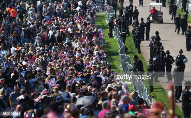 Royal fans gather outside Windsor Castle ahead of wedding of Britain's Prince Harry to Meghan Markle in Windsor on May 19 2018 in Windsor England