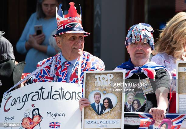 Royal fans gather outside Windsor Castle on May 17 2018 in Windsor England Preparations continue in the town for the wedding between Prince Harry and...