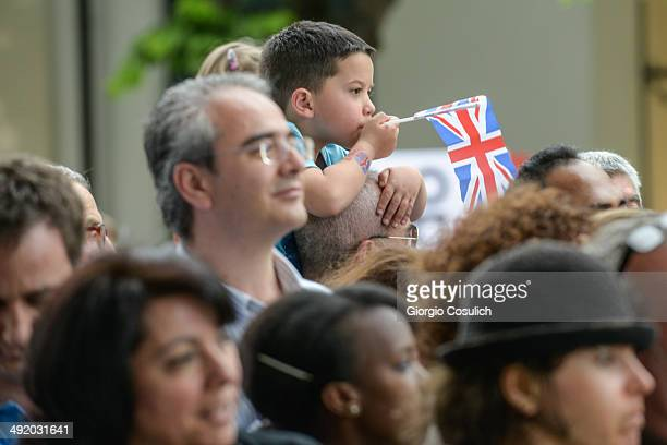 Royal fans hold English flags as they wait for the arrival of Prince Harry at the Maxxi Museum on May 18 2014 in Rome Italy Prince Harry is on a two...