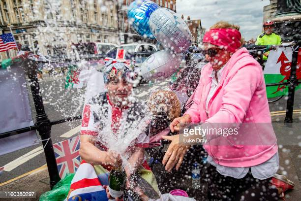 Royal fans John Loughrey and Ann Daley celebrate the christening by a opening a champagne bottle on the day that Archie Harrison MountbattenWindsor...