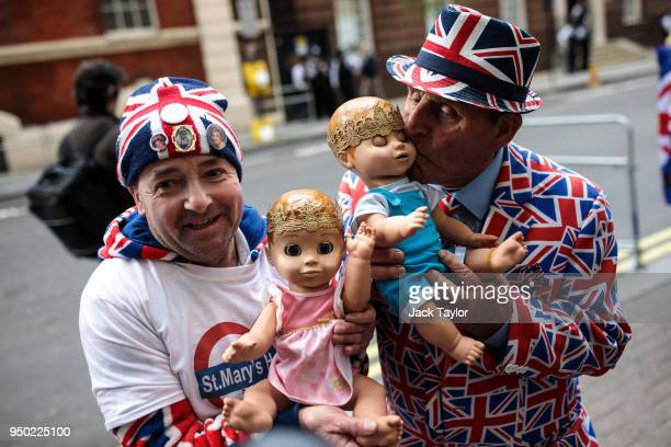 Royal fans John Loughrey and Terry Hutt pose with baby dolls outside the Lindo Wing of St Mary's Hospital ahead of the birth of the Duke Duchess of...