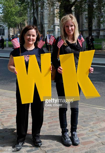 Royal fans Olivia Wofford and her mother Christine from Michigan USA pose for a photograph with the initials W and K for William and Kate outside...