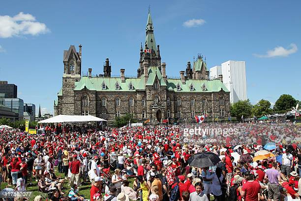 Royal fans take part in Canada Day Celebrations as they wait to catch a glimpse of Prince William Duke of Cambridge and Catherine Duchess of...