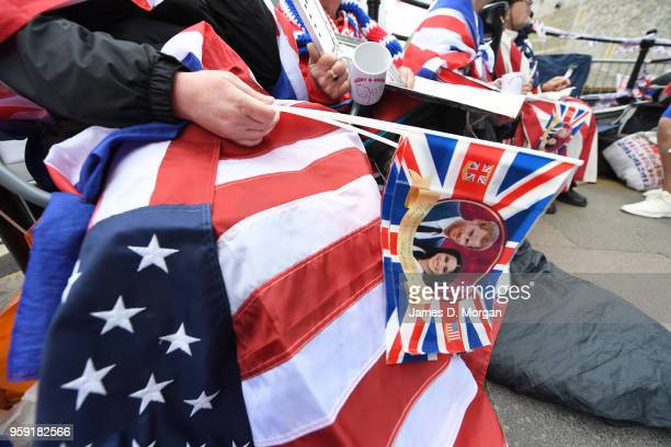 Royal fans wait on the streets near the castle on May 16 2018 in Windsor England Preparations continue in the town for the wedding between Prince...
