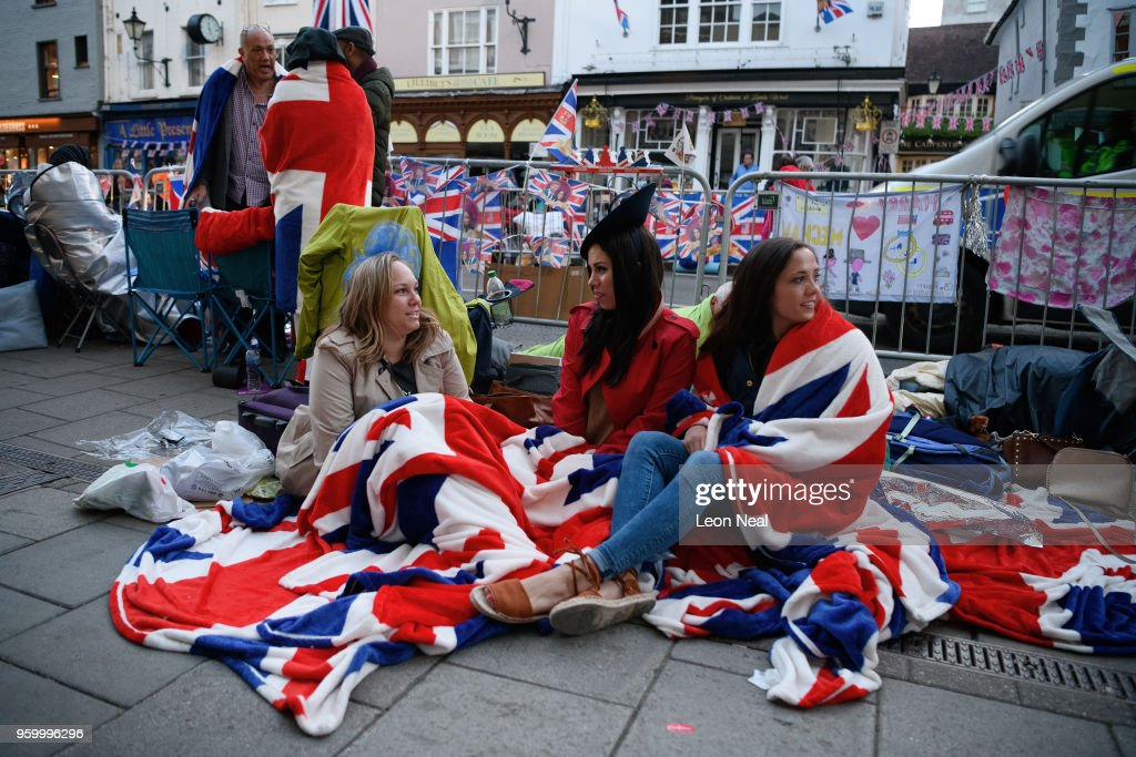 Royal fans wake and prepare themselves, as media, tourists and royal fans gather near Windsor Castle, on the day of the wedding of Prince Harry and Meghan Markle, on May 19, 2018 in Windsor, England.