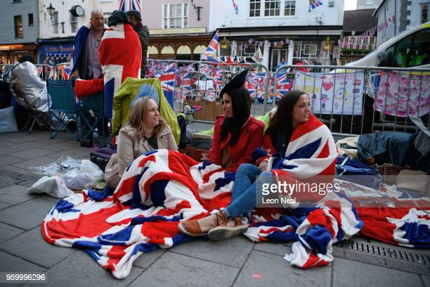 Royal fans wake and prepare themselves as media tourists and royal fans gather near Windsor Castle on the day of the wedding of Prince Harry and...