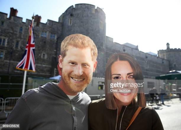 Royal fans wear Harry and Catherine Duchess of Cambridge masks outside Windsor Castle ahead of the dress rehearsal for the wedding of Prince Harry...