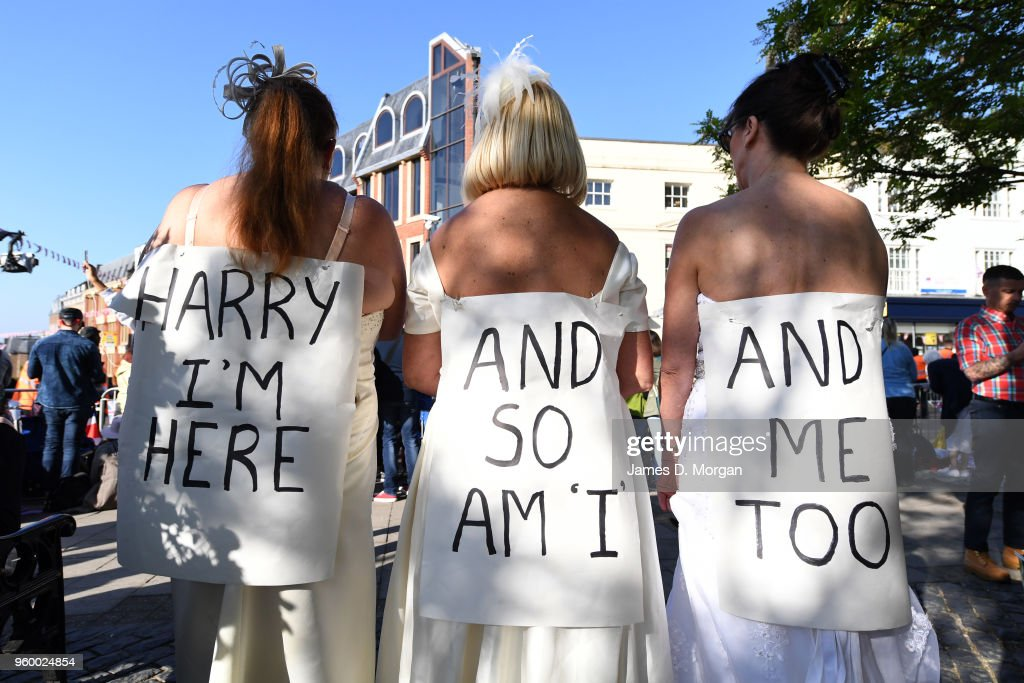 Royal fans wear wedding dresses near the castle before the wedding of Prince Harry to Ms. Meghan Markle at St George's Chapel, Windsor Castle on May 19, 2018 in Windsor, England. Prince Henry Charles Albert David of Wales marries Ms. Meghan Markle in a service at St George's Chapel inside the grounds of Windsor Castle. Among the guests were 2200 members of the public, the royal family and Ms. Markle's Mother Doria Ragland.