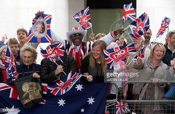 TOPSHOT Royal fans with Union Flags and the Australian flag cheer at the barriers ahead of a service of thanksgiving for the 90th birthday of...