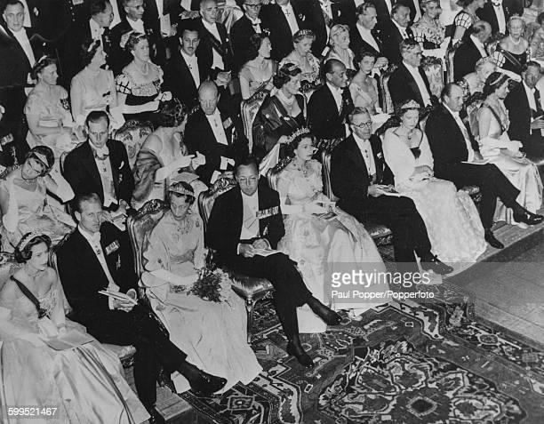 Royal figures of Europe sit together in the front row of the audience of a festival performance Princess Margaret Prince Philip Duke of Edinburgh...