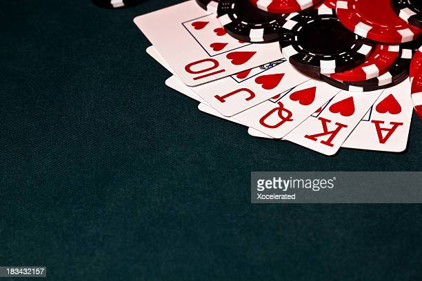 royal flush with black and red poker chips - texas hold 'em stock pictures, royalty-free photos & images