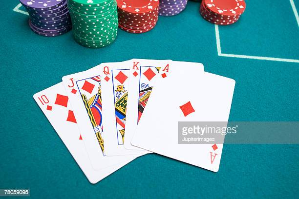 royal flush with poker chips - royal flush stock photos and pictures