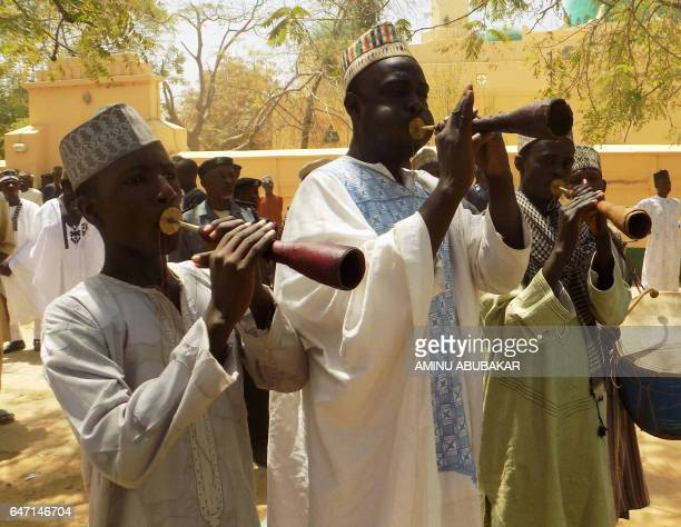 Royal flutists perform during the mass wedding of 1520 couples at the city's central mosque on February 26 2017 The Emir of Kano wants to put an end...