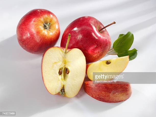'royal gala' apples, whole and cut into pieces - royal gala apple stock photos and pictures
