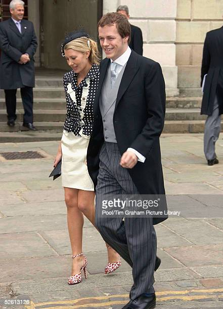 Royal godson Tom ParkerBowles with his fiancee Sara Buys attends the civil ceremony marriage of HRH the Prince of Wales Prince Charles and the...