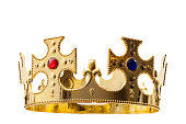 Royal gold, regal attire and royalty concept theme with a king s golden crown isolated on white background with a clip path cutout