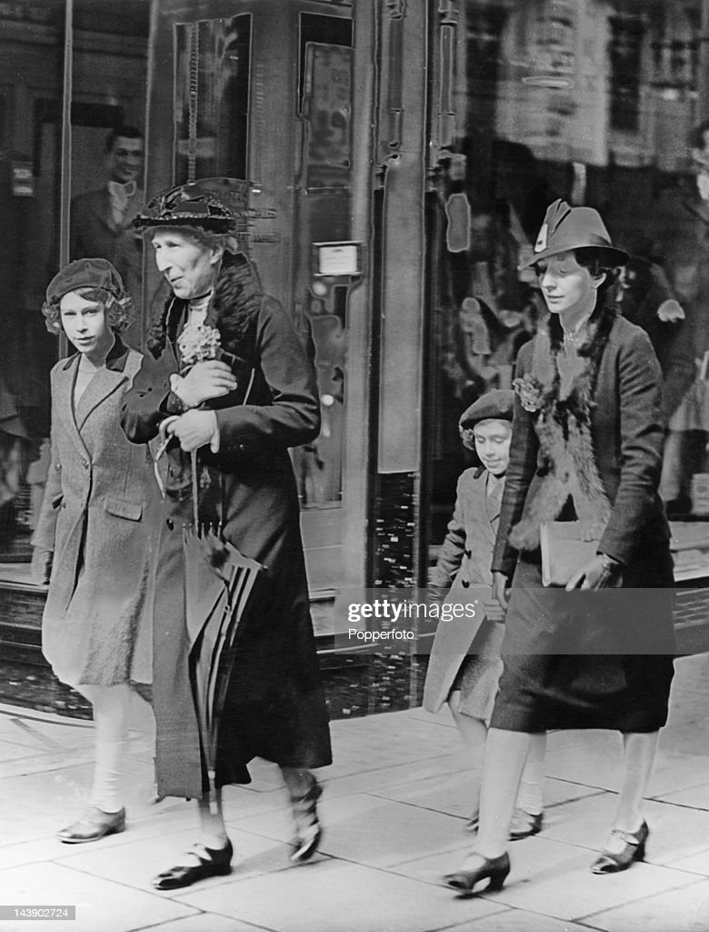 Royal governess Marion Crawford ('Crawfie', 1909 - 1998, right) accompanies Princesses Elizabeth (later Queen Elizabeth II, left) and Margaret (1930 - 2002) to a London Underground station, on their way to visit the headquarters of the YWCA (Young Women's Christian Association), off Tottenham Court Road, London, 15th May 1939. This will be the princesses' first ride on the Underground.