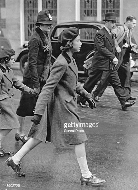 Royal governess Marion Crawford accompanies Princesses Elizabeth and Margaret to the headquarters of the YWCA off Tottenham Court Road London 15th...