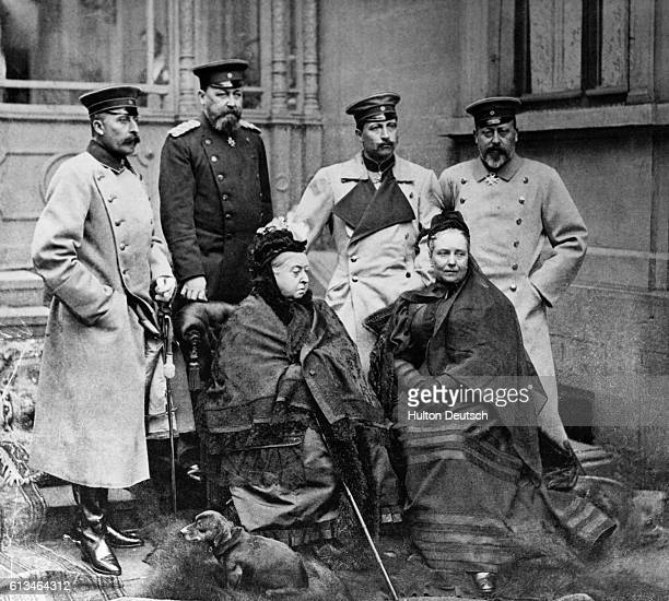 Royal group at Palais Edinburgh, Coburg. Back row, right to left: Prince of Wales, later Edward VII, Victoria's grandson, Wilhelm II Emperor of...