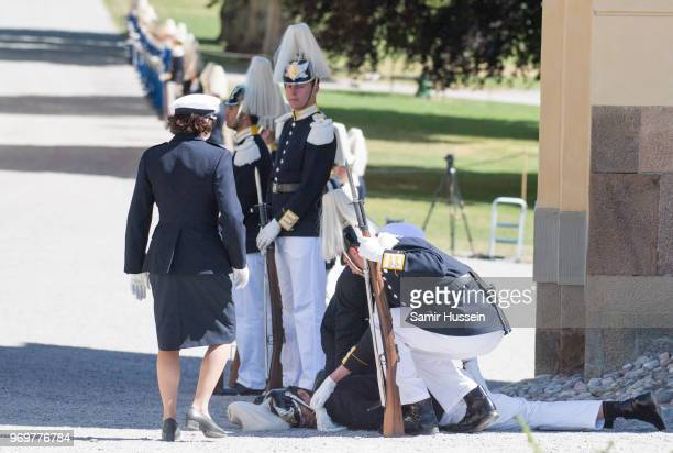 A royal guard collapses during the christening of Princess Adrienne of Sweden at Drottningholm Palace Chapel on June 8 2018 in Stockholm Sweden