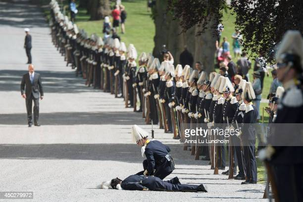 Royal guard faint due to hot weather at the Royal Christening for Princess Leonore at Drottningholm Palace Chapel on June 8, 2014 in Stockholm,...