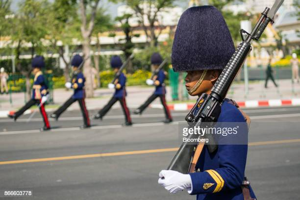 Royal Guards march along the funeral route for the cremation procession of the late King Bhumibol Adulyadej at Sanam Luang ceremonial ground in...