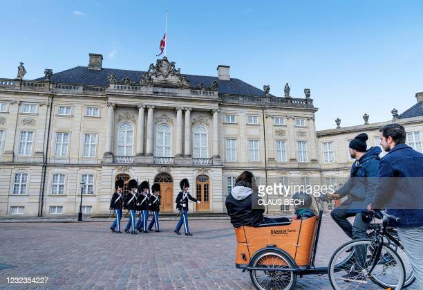 Royal guards march as the Danish national flag flies at half mast at Amalienborg Palace in Copenhagen on April 17 on the occasion of the funeral of...