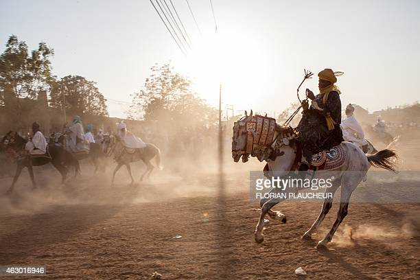 Royal Guards of the emir Muhammad Sanusi II race February 8 in Kano Nigeria during a Durbar ceremony in honor of the coronation of the emir Sanusi a...