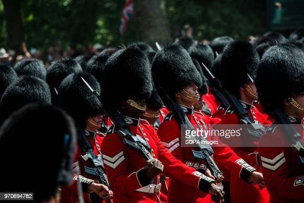 Royal Guards seen marching on the way to Buckingham Palace. The ceremony of Trooping the Colour is believed to have first been performed during the...