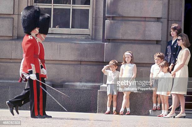 Royal Guardsmen at Buckingham Palace watched by left to right John F Kennedy Junior and his sister Caroline his cousins Anthony and Anna Radziwill...