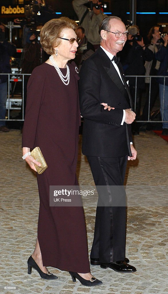 Royal Highnesses Grand Duke Jean (R) and Grand Duchess Josephine Charlotte attend a dinner and party at the Royal Palace in honor of the wedding of Dutch Crown Prince Willem-Alexander and Maxima Zorreguieta January 31, 2002 in Amsterdam, The Netherlands.